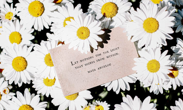 Photo of daisies with poem.